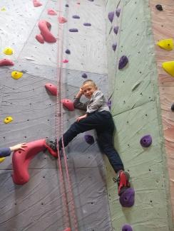 Alexander in rock climbing class
