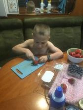 Alexander helping prepare breakfast