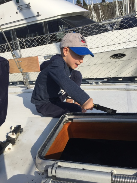 Alexander helping with boat projects